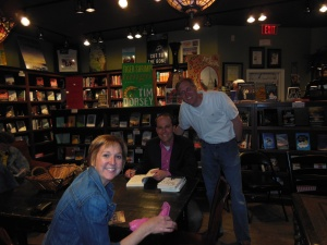 Signing a book for friends, Phil and Debbie Wright