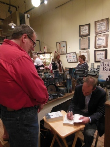 Signing a book at Harrison Brothers
