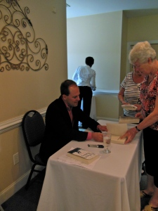 Signing books at the Moveable Feast