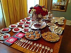Alabama themed book club at Sheila Irby's home!  Check out the Bama napkins and the little hound's tooth hats in the floral centerpiece.